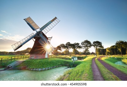 morning sunshine behind Dutch windmill, Holland