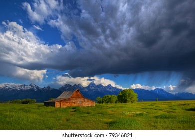 Morning thunderstorm passes over Grand Teton National Park and Moulton Barn, Mormon Row.