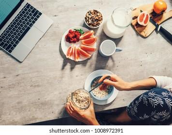 Morning time - woman prepare healthy breakfast