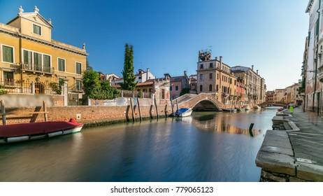 Morning in Venice timelapse. Canal (channel), bridges, historical, old houses and boats. Scenic cityscape view. Venice, Italy. Blue sky at summer day