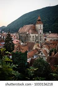 Morning view of Black Church (Biserica Negra) in Brasov, Transylvania, Romania. Vertical travle destination postcard.