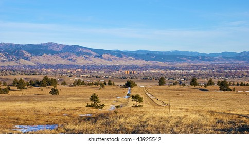 Morning view of Boulder, Colorado, at the edge of the Rocky Mountains, from the south