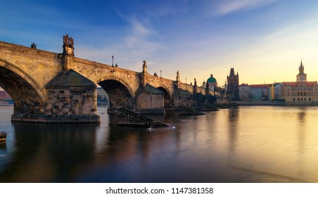 Morning view of Charles Bridge in Prague, Czech Republic. The Charles Bridge is one of the most visited sights in Prague. Architecture and landmark of Prague.