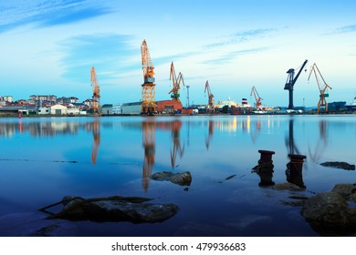 Morning view of   cranes  in cargo seaport of Maliano. Santander