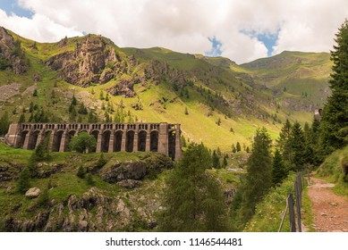 Morning view of the Gleno dam from the path that arrives in the Val di Scalve, in Lombardy, landscape image