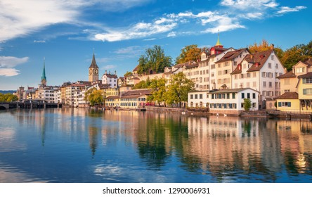 Morning view of historic Zurich city center with famous Fraumunster and Grossmunster Churches and river Limmat at Lake Zurich on a sunny day with clouds in summer, Canton of Zurich, Switzerland