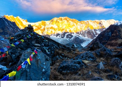Morning view of Mount Annapurna I from Annapurna base camp with prayers flags, round Annapurna circuit trekking trail, Nepal.