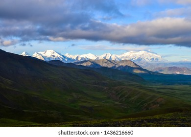 Morning view of Mount Denali (mt Mckinley) peak during golden hour from Stony Dome overlook. Denali National Park and Preserve, Alaska, United States
