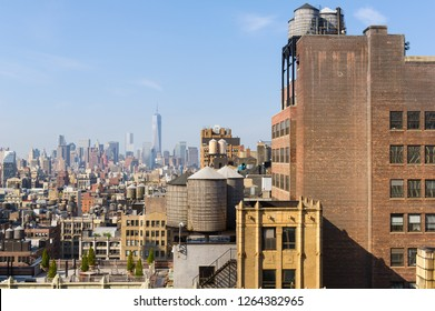 Morning view of New York City, USA, skyline with urban skyscrapers. The World Trade Center area is visible in the background. Water towers are in the frame.