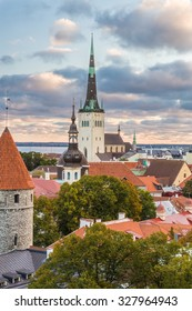 Morning view of old town Tallinn, Estonia. Oleviste church and medieval roofs