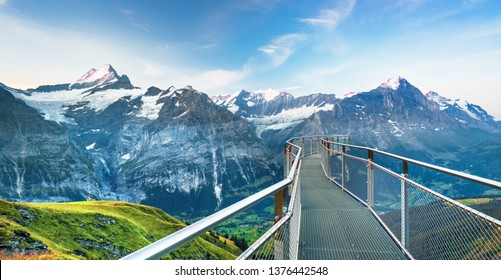 Morning view on Bernese range above Bachalpsee lake with Mounch, Eiger Faulhorn and Reti peaks. Popular tourist destination. Location place Switzerland alps, Grindelwald valley, Europe.