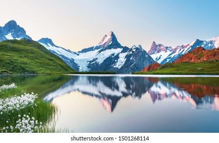 Morning view on Bernese range above Bachalpsee lake. Popular tourist attraction. Location place Switzerland alps, Grindelwald valley, Europe.