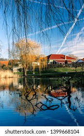Morning view on a spring day over a calming lake in Odense, Denmark