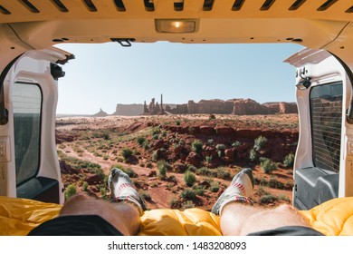 Morning view out the back of a campervan on an American road trip, shot in Monument Valley, United States of America.
