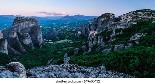 Morning view over the Meteora valley with monasteries built on a rocky cliff during sunrise
