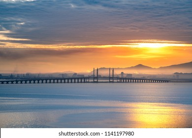 Morning view of penang bridge 1 , sunrise at Penang Island, Travel Malaysia , waterside view landscape, Industrial city