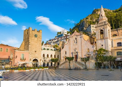 Morning view of Square Piazza IX Aprile with San Giuseppe church and Clock Tower in Taormina, Sicily, Italy. Taormina located in Metropolitan City of Messina, on east coast of island of Sicily.