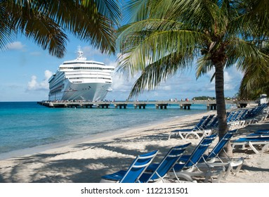 The morning view of still empty beach and a cruise liner that just arrived to Grand Turk island (Turks and Caicos Islands).