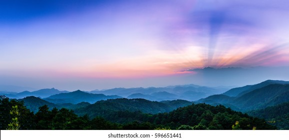Morning view with sun-ray in national park with foggy environment.