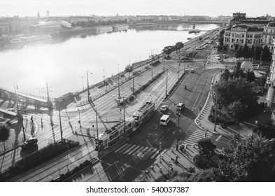 Morning view of tram and cars on the crossing near Liberty bridge in Budapest, Hungary. Unusual black and white postcard.