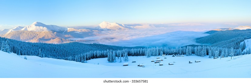 Morning winter calm mountain panorama with sheds group and mount ridge behind (Carpathian Mountains, Ukraine).