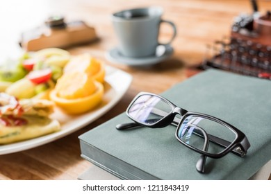 morning working with breakfast on table with nobody