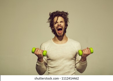 Morning workout. sleepy man with barbell or dumbbell workout, has disheveled and uncombed long hair and beard on yawning face in white underwear on grey background, morning exercise and wake up