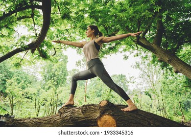 Morning Yoga Flow outdoors in park with young beautiful woman instructor