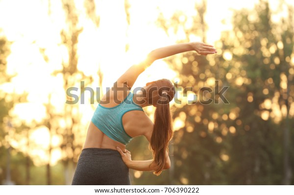 Morning of young sporty woman training in park