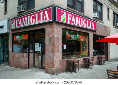 Morningside Heights, New York, NY, USA - August 19, 2021: Window of Famous Famiglia pizza shop at 2859 Broadway