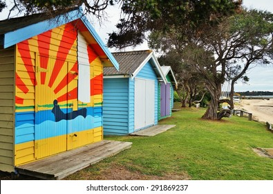 MORNINGTON, AUSTRALIA --6 AUGUST 2014-- Colorful beach cabins line the shores of the Mornington Peninsula overlooking the skyline of Melbourne, Australia's second largest city.