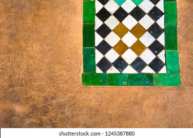 Moroccan ceramic tiles and plaster background in Marrakesh