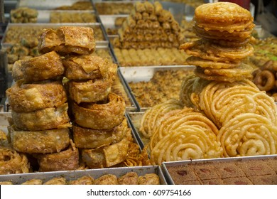 moroccan chebakia and varied pastry cookies for sale at the market, street. food and business concept. Selective focus.