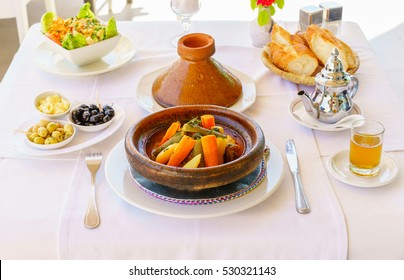 Moroccan dinner: tajine, olive, traditional mint tea, salad and bread.