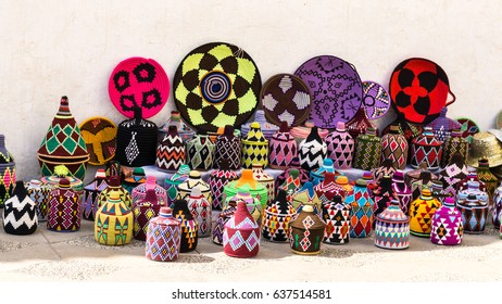 Moroccan Handicraft Souvenirs.  These colorful handicraft bottles and baskets were on display and for sale on the streets of the Medina Tangier.