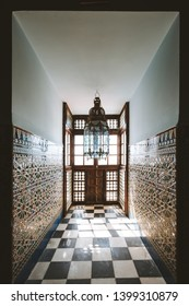 Moroccan interior with window in the sunlight and mosaic walls. beautiful moroccan lamp.