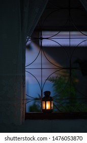 Moroccan lantern lit in the window