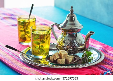 Moroccan Mint Green Tea in Two Glasses and a Teapot With Fresh Mint and Sugarcubes