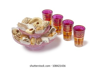 Moroccan mint tea with cookies and mint tea on white background