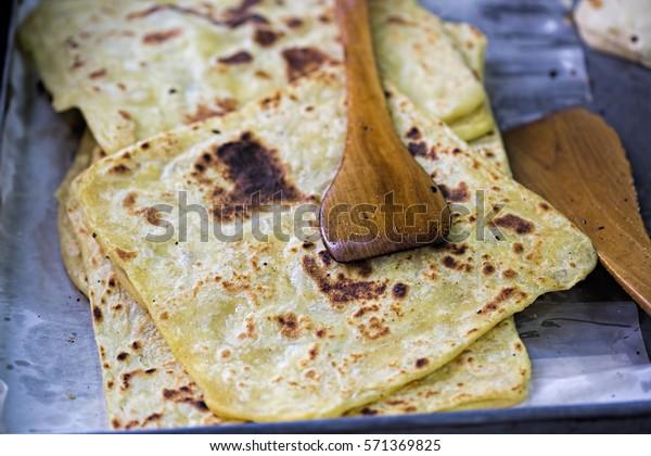 Moroccan Msemen stacked. Square flatbread prepared on the grill, Marrakech, Morocco