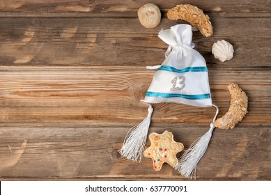 Moroccan oriental sweets and a gift for the guests at the bar mitzvah .A Jewish boy automatically becomes Bar Mitzvah when he turns 13  years old.Copy space.Wood background. Top view.