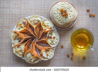 Moroccan pancakes with herbal tea. Middle Eastern food.