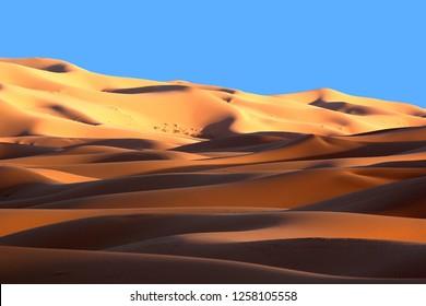 Moroccan Sahara sand dunes and shadows at sunset