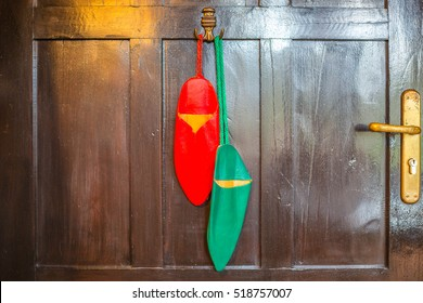 Moroccan slippers babouche hangs on hanger: red and green