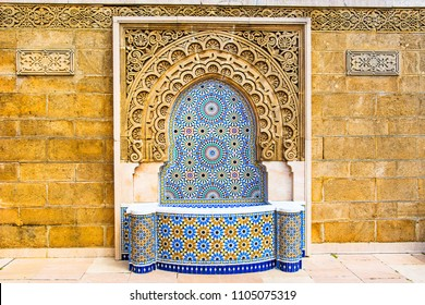 Moroccan style fountain with fine colorful mosaic tiles at the Mohammed V mausoleum in Rabat Morocco