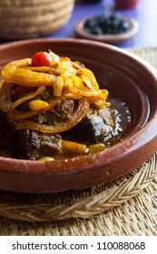 A Moroccan tajine dish with meat, onion and raisin