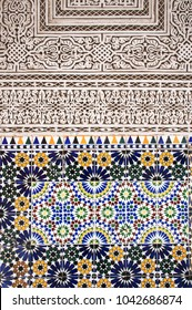 Moroccan tile art. Relief tiles and colorful mosaic, background graphic arabic art. Bahia palace marrakech. ornamental interior design, hand crafted.