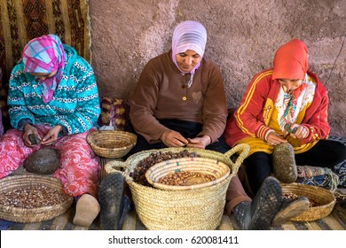 Moroccan women in national traditional dress make argan oil in open workshop. High Atlas. Morocco. 13th April 2016