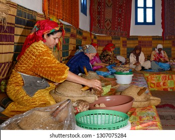 Moroccan womens cooperative at Afous Argan making argan oil by hand in a production line Essaouira, Morocco - November 11, 2010