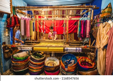 Morocco- 05.05.2018: Man weaves on loom the traditional colorful  fabric with wooden weaving loom, Colorful background and fabrics. Morocco.